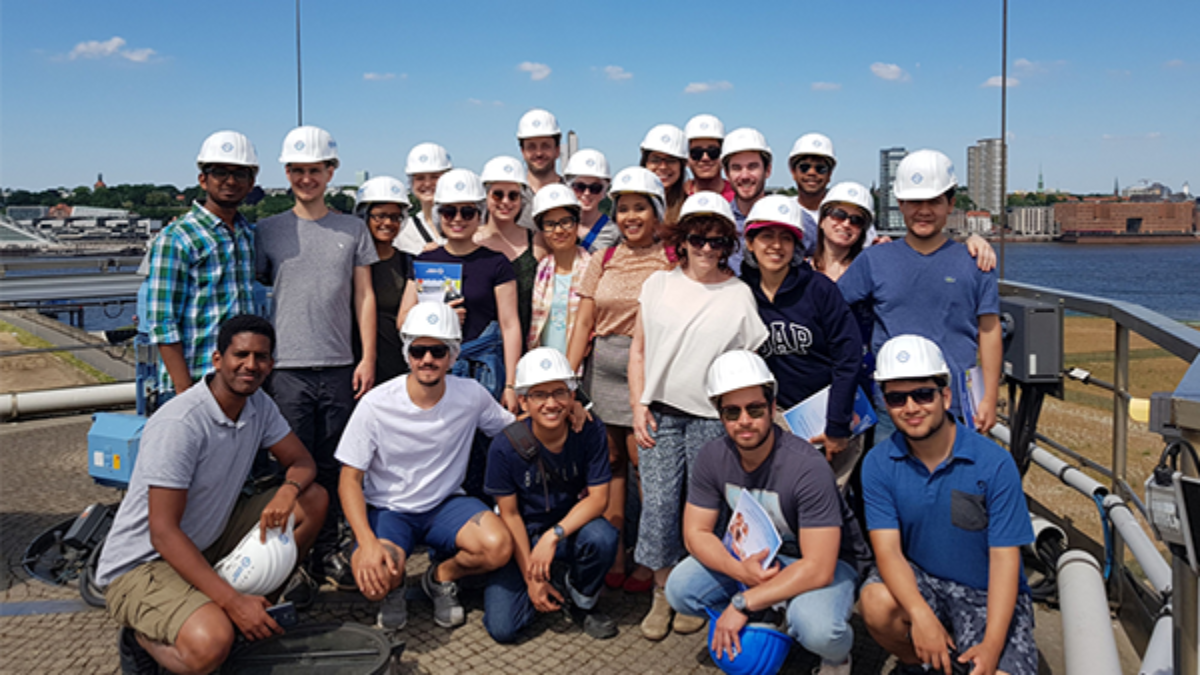 WAREM Excursion Mai 2018, Waste Water Treatment Plant, Hamburg Group of students with white helmets,standing on the digestion tower of the Waste Water Treatment plant , Hamburg (c)